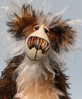 Baron Marcel von Crinklehoven is a comical yet handsome, one of a kind, artist bear by Barbara-Ann Bears in wonderful fluffy tipped mohair. Baron Marcel von Crinklehoven stands 15.5 inches(39 cm) tall and is 12 inches(31 cm) sitting.
