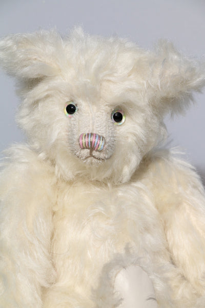 Blossom is a sweet and cuddly, traditional mohair teddy bear by Barbara Ann Bears, she is about 11 inches (28 cm) tall and is 8.5 inches (21cm) sitting. Blossom is made from a beautiful, dense and fluffy creamy white mohair with creamy white leather paw pads and she has beautiful hand painted glass eyes.