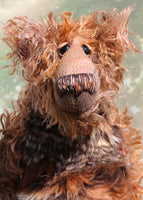 Boris has beautiful hand painted slightly sparkling glass eyes (they were painted to match his mohair) with hand-coloured eyelids, an impressive and wonderfully embroidered nose, sewn from individual threads to match his mohair and an engaging smile.