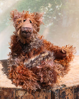 Boris Stroganov is a wild yet friendly, one of a kind, artist bear by Barbara-Ann Bears, he stands 19 inches(48 cm) tall and is 15 inches(38 cm) sitting.  He is made from long, wild and shaggy mohair that Barbara has hand-dyed in many beautiful hues of brown this is complemented by his long and very fluffy faux fur