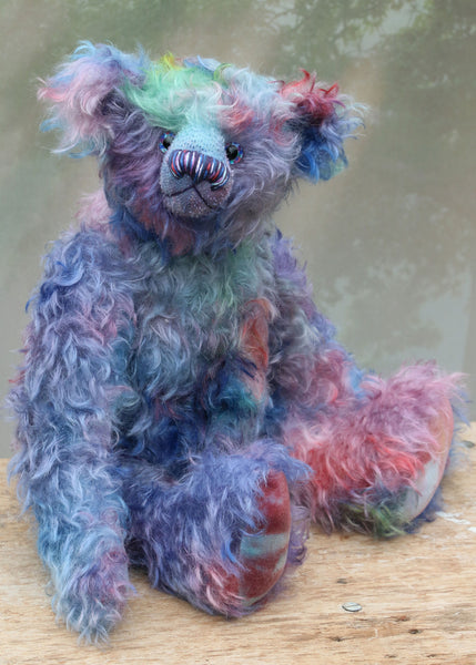 Braedon, a traditional, one of a kind artist teddy bear, in fabulous hand dyed mohair by Barbara Ann Bears, he stands 15 inches/38cm tall and is 10.5 inches/27cm sitting. Braedon is made from medium length distressed German mohair hand-dyed by Barbara  in shades of blue with splashes of pink, lilac, emerald and plum