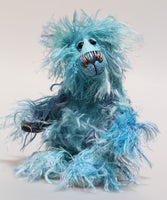 Brian is a very happy, shaggy and comical one of a kind, artist teddy bear by Barbara-Ann Bears in fabulous blue hand-dyed mohair. He stands 8.5 inches( 22 cm) tall and is 6.5 inches ( 17 cm) sitting. He  is mostly made from a long, wildly tousled fluffy mohair that Barbara has hand dyed in a beautiful array of blues