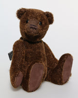 Bruno is a gorgeous little one of a kind traditional teddy bear made from beautiful rich brown mohair by Barbara Ann Bears He is made from a fairly short and sparse, straight pile, almost tufty, deep brown German mohair, he has matching brown, German wool-felt paw pads and antique black boot buttons for eyes