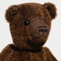 Bruno is a gorgeous little one of a kind traditional teddy bear made from beautiful rich brown mohair by Barbara Ann Bears. Bruno has antique black boot buttons for eyes, a perky little brown nose carefully and a sweet expression that seems both sad and hopeful, like a puppy.