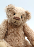 Buster is a very sweet and friendly, quite traditional, one of a kind, mohair artist teddy bear by Barbara Ann Bears, he stands 10 inches/25 cm tall and is 7.5 inches/19 cm sitting. Buster is made from beautiful, quite sparse, fairly straight, soft beige mohair, with German wool-felt paw pads and spherical, glass eyes