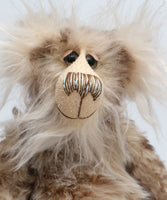 Calhoun is a charming and very friendly, one of a kind, artist bear by Barbara-Ann Bears in wonderfully fluffy tipped mohair and faux fur, he stands 11.5 inches(29 cm) tall and is 8.5 inches (21 cm) sitting.