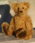 Carnoustie is an elegant and charming, one of a kind, traditional artist teddy bear by Barbara Ann Bears , he stands 15.5 inches/39cm tall and is 11 inches/28 cm sitting. Carnoustie is made from a beautiful, dense and curly antique gold coloured German mohair, with German wool-felt paw pad and boot buttons for eyes