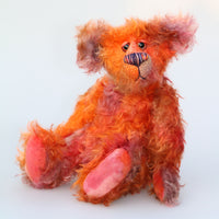 Chipotle is a wild and fiery, yet still very friendly, one of a kind artist bear in beautiful hand dyed mohair by Barbara-Ann Bears Chipotle stands 11 inches(28 cm) tall and is 8 inches (21 cm) sitting. Chipotle is a wild and shaggy chap, a bear who loves to walk across the hottest deserts, to be alone under the fiercest sun
