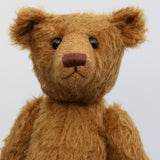 Cinnamon has boot buttons for eyes, just like the really old teddy bears. He has a carefully embroidered nose and a sweet smile