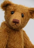 Cinnamon is the first of his design . He was designed to be proportioned like the very earliest teddy bears, with longer arms, a long snout and to be quite bear-like, not too cute but still very lovable.