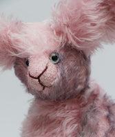 Clover Blossom is a very sweet and gentle, one of a kind rabbit in beautifully coloured mohair by Barbara Ann Bears Clover Blossom stands 9.5 inches( 24 cm) tall and is 7 inches (18cm) sitting, her ears are 8.5 inches (22 cm) across the top. Clover Blossom is a little sweetie, a beautifully coloured rabbit with a heart of gold.