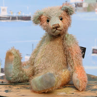 Cyril is a very handsome & subtly colourful, traditional, one of a kind artist teddy bear, in hand dyed mohair by Barbara Ann Bears, he stands 8.5 inches (21 cm) tall and is 6 inches (15 cm) sitting. Cyril is made from a fairly short and sparse German mohair hand-dyed in natural hues of jade, turquoise and a soft peach