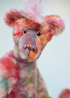 Deedee is both wild and cute, a gently colourful & loveable, one of a kind, hand dyed mohair artist bear by Barbara-Ann Bears Deedee stands 16 inches (41 cm) tall and is 11.5 inches (29 cm) sitting, this doesn't include her beautiful pink hair which adds another 2 inches (5 cm).