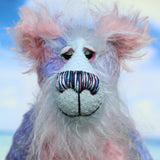 Delilah's face is a very long, soft and wispy pale blue mohair. Delilah Dingles has beautiful, hand painted glass eyes with hand coloured eyelids, a splendid nose embroidered from individual threads to compliment her colouring and she has a broad, friendly smile