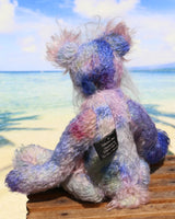 Delilah Dingles is mostly made from a medium length, sparse, quite straight mohair that Barbara has dyed in several gentle shades of blue with small splashes of pink, violet and green.