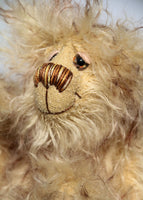 Dinsdale is a very scruffy, cute and quite little one of a kind artist bear in wonderfully shaggy tipped mohair by Barbara-Ann Bears Dinsdale stands just 7 inches (18 cm) tall and is 5 inches (13 cm) sitting. Dinsdale is a wild and shaggy chap made from the most wonderful, shaggy and feathery, brown tipped beige mohair