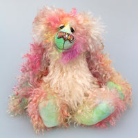 Dorothy is a sweet and pretty, beautifully coloured, one of a kind artist bear, in gorgeous hand dyed mohair by Barbara-Ann Bears. Dorothy stands 12 inches( 30cm) tall and is 9 inches (23 cm) sitting.
