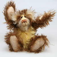Dylan Dymble is a wild yet sweet, one of a kind, artist teddy bear made in wonderfully shaggy mohair by Barbara-Bears' he stands 9.5 inches( 24 cm) tall and he is 7 inches (18 cm) sitting.