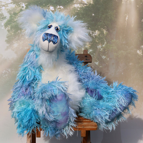 Elvis is a fabulous and charismatic, one of a kind, sky blue and white, artist teddy bear in gorgeous hand-dyed mohair by Barbara-Ann Bears Elvis stands 23 inches (59 cm) tall and is 16.5 inches (41 cm) sitting, he's one big, heavy bear!  His colours are like big fluffy clouds drifting across a summer's sky