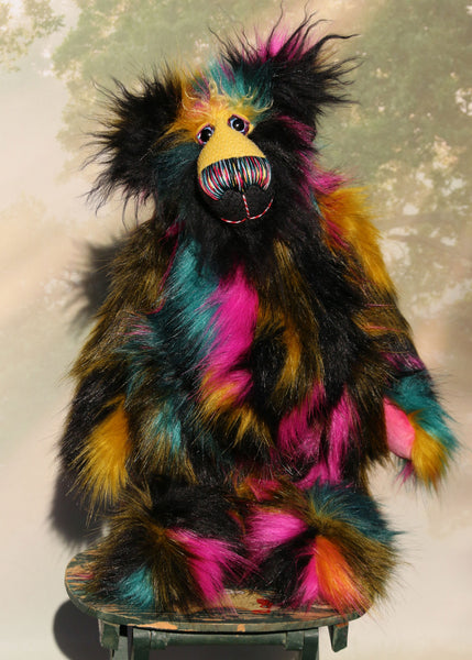 Fabian Funtuttle is an exotic and colourful, one of a kind, artist bear by Barbara-Ann Bears in luxurious mohair and rather wild faux fur Fabian Funtuttle stands 16 inches (40 cm) tall and is 12 inches (30 cm) sitting. Fabian Funtuttle is a rather wild and playful chap, a teddy bear for those who like colour and fun!