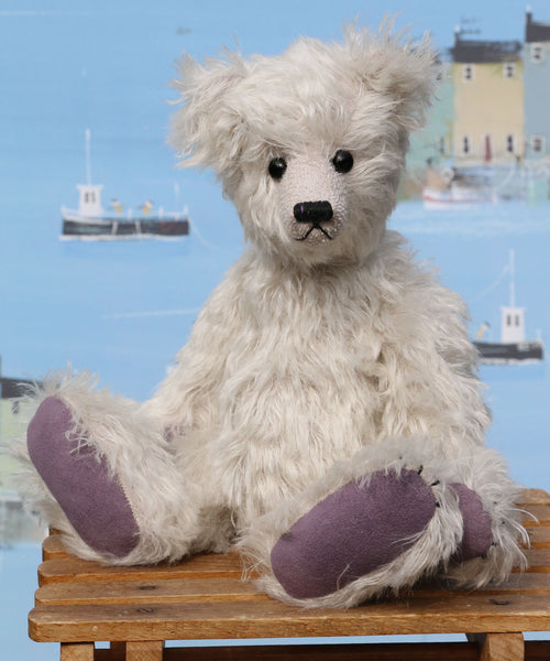 Fairbrother is a sweet and gentle, one of a kind, traditional artist teddy bear made from beautiful German mohair, by Barbara-Ann Bears Fairbrother stands 12 inches (30cm) tall and is 9 inches (23cm) sitting Fairbrother is made from beautiful, slightly wavy, silver German mohair which has a hint of lilac in the backing