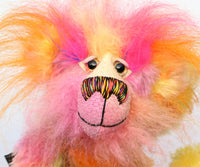 Wowzer is an extremely cheerful multi-coloured bear, a bear of beautiful, vivid, spicy colours