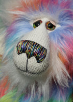 Festive Freda has large, beautiful, hand painted glass eyes with hand coloured eyelids, she has a carefully embroidered nose that incorporates all of his colours and an exuberant beaming smile. Festive Freda's face and the fronts of her ears are made from a very long and soft white mohair which sets off her colours beautifully
