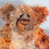 Fletcher McTrossach is a wild highland mountain bear, a one of a kind artist bear in beautiful hand dyed mohair by Barbara-Ann Bears Fletcher McTrossach stands 12 inches(30 cm) tall and is 9 inches (23 cm) sitting. Fletcher McTrossach is a wild and shaggy chap, a bear who loves to climb wild desolate mountains, to be alone in the fiercest of gales, to feel the wind tugging at his glorious fur.