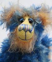 Flynn is a wonderfully happy one of a kind, hand dyed mohair artist teddy bear by Barbara-Ann Bears, like the sun shining in a blue sky. Flynn stands just 7.5 inches( 19 cm) tall and is 6 inches ( 15 cm) sitting.