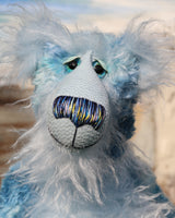 Frank Fairweather has large, beautiful, hand painted glass eyes which sparkle like jewels and have eyelids and even eyelashes! He has a carefully embroidered nose that incorporates all of his colours and a sweet, thoughtful smile. He is made from a beautiful, dense, slightly distressed mohair which Barbara has hand dyed in many gorgeous shades of the most beautiful blues. His face, tummy, the fronts of his ears and the underside of his tail are made from a very long and fluffy sky blue mohair