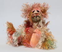 Freddie Fogwatt is a wild thing, yet a very friendly wild thing, a one of a kind, hand dyed mohair artist bear by Barbara-Ann Bears, he stands 10.5 inches (26 cm) tall and is 8 inches (20 cm) sitting. He is made from a gorgeous, long, straggly mohair that Barbara has dyed in a multitude of natural colours