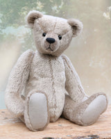 Frederick is a very sweet and cuddly, traditional teddy bear by Barbara Ann Bears, he stands 15.5 inches (39cm) tall and is 11.5 inches (29cm) sitting. Frederick is made from a silvery-grey German mohair with a straight, fairly short pile and a soft brown backing he has grey wool felt paws and vintage boot buttons eyes