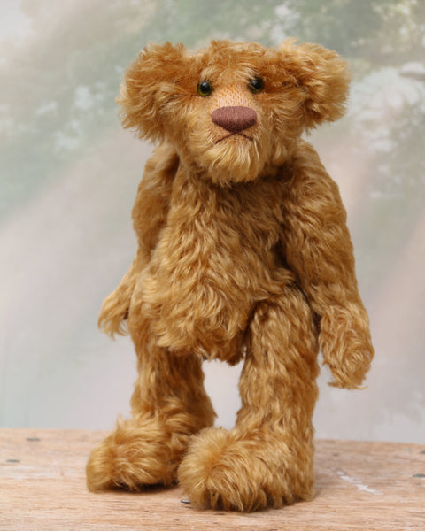 Funky Frankie is a wild and groovy guy, a veteran mohair artist bear from Barbara-Ann Bears, he stands 11 inches (28cm) tall and is 8 inches (20cm) sitting.  Funky Frankie was made in the late 1990s from beautiful English mohair, it's a rich, antique gold, gently distressed mohair and he has brown wool felt paw pads