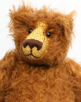 Garth is a very sweet and cuddly, artist teddy bear by Barbara Ann Bears in wonderful chocolate brown mohair, he stands 11 inches/28 cm tall and is 8.5 inches/21 cm sitting. Garth is made from a beautiful, slightly distressed brown German mohair with matching German wool-felt paw pads and small amber glass eyes