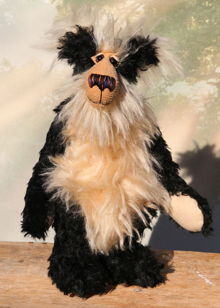 Gaston is a distinguished, fluffy and friendly one of a kind artist teddy bear in stunning black and cream mohair by Barbara-Ann Bears, he stands 15 inches (39 cm) tall and is 12 inches (28 cm) sitting. Gaston is mostly made from a distressed black mohair contrasted with a very long creamy-beige mohair