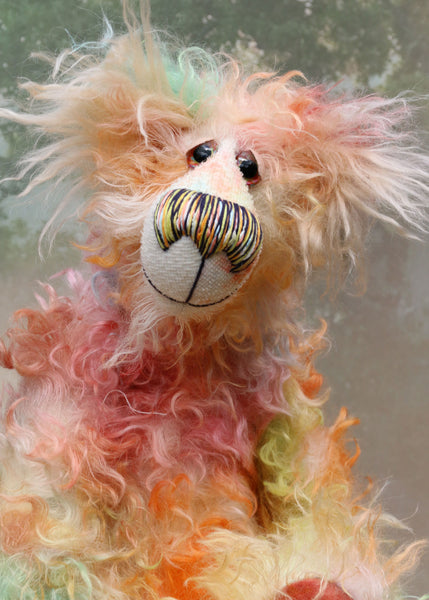 Goose, a sweet bear of gentle hilarity, a one of a kind, artist bear by Barbara-Ann Bears in delicately colourful, shaggy hand dyed mohair, he stands 16 inches (39 cm) tall and is 12 inches (30 cm) sitting and is made from a long shaggy distressed mohair that Barbara has hand dyed in a gorgeous blend of pastel colours.
