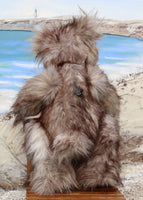 Grizzly George Gruffletruffle is a wild and wonderful, one of a kind, artist teddy bear in gorgeous faux fur & mohair by Barbara-Ann Bears Grizzly George Gruffletruffle is quite a large teddy bear, he stands 18 inches (46 cm) tall and is 14.5 inches (37 cm) sitting. Grizzly George Gruffletruffle is a big, heavy bear with a very dignified and relaxed manner