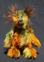 Grunyan is a very happy and beautifully coloured teddy bear, a one of a kind, hand dyed mohair artist bear by Barbara-Ann Bears, he stands 9.5 inches (24 cm) tall and is 7.5 inches ( 19 cm) sitting.  Grunyan is a mixture of beautiful natural colours, the colours of a cool, dark forest where the elk and the bears roam.