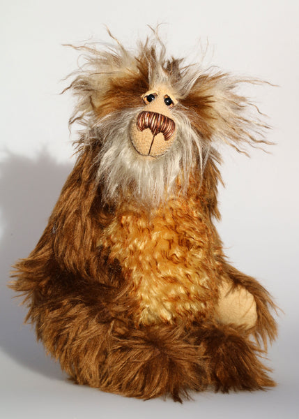 Harvey Nutbundler, an appealingly wild and friendly one of a kind artist teddy bear in stunning mohair by Barbara-Ann Bears Harvey Nutbundler stands 12.5 inches (31 cm) tall and is 9.5 inches (24 cm) sitting. Harvey Nutbundler is a sweet, handsome bear, a bear who can be seen wandering through open woodland collecting nuts and berries