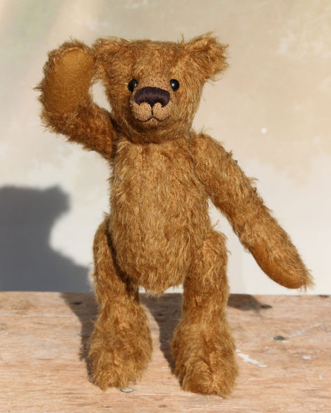 Homer is a charming, traditional one of a kind artist bear in German mohair by Barbara Ann Bears, he stands 10 inches/27 cm tall and is 7.5 inches/22 cm sitting. Homer is made from beautiful, slightly distressed, brown German mohair with a hint of khaki, matching wool-felt paw pads and vintage boot buttons for eyes