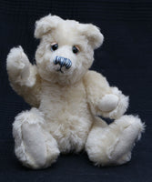 Izzy is one of our old bears, he's a sweet and chirpy, traditional teddy bear made from gorgeous English mohair by Barbara Ann Bears. Izzy stands 10.5 inches (26cm) tall and is 8 inches (20cm) sitting.