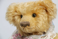 Jasmine is a very sweet and pretty one of a kind traditional mohair artist teddy bear by Barbara Ann Bears, she stands 13.5 inches (34 cm) tall and is 10 inches (25 cm) sitting. Jasmine is made from soft yellow mohair with mushroom coloured wool felt paw pads, green glass eyes, and she has a straw hat and lace collar.