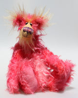 Mr Jazzicle, a gorgeous, kooky and gloriously pink, a one of a kind artist bear in stunning hand dyed mohair by Barbara-Ann Bears. He stands 15 inches( 37 cm) tall and is 11.5 inches ( 29 cm) sitting, mostly made from a long, wildly distressed mohair that Barbara has dyed in a gorgeous blend of magenta and softer pinks