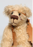 Jericho Joe is a youthful, playful teddy bear who likes to play and dress up, a veteran artist bear from Barbara-Ann Bears from the 1990s, he stands 12 inches (30 cm) tall and is 9 inches (23 cm) sitting. He was made from a pale beige German mohair, he has beige wool felt paw pads and pale amber translucent glass eyes