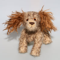 Jessie is a friendly and appealingly scruffy, artist teddy dog made in beautiful German mohair by Barbara Ann Bears. Jessie stands 10.5 inches( 26 cm) tall, she is 12 inches (31 cm) from nose to the base of her tail and she is 10.5 inches (26 cm) across the ears.