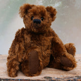 Kipling is a very sweet and cuddly, one of a kind, traditional artist teddy bear by Barbara Ann Bears, he stands 13 inches/33cm tall and is 10 inches/25 cm sitting. Kipling is made from a beautiful, slightly distressed German mohair which is the colour of the most delicious chocolate, he has matching wool-felt paw pads