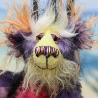 Lickle Pickle has beautiful, hand painted eyes with hand coloured eyelids, a splendid little nose embroidered from individual threads to match his colouring and he has a sweet, friendly smile