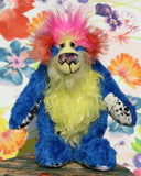 Ludo is a wild and wonderful celebration of colourful happiness, a one of a kind, hand dyed mohair artist bear by Barbara-Ann Bears, he stands 9.5 inches( 24 cm) tall and is 7.5 inches ( 19 cm) sitting. He's mostly a medium length distressed, intensely blue mohair with lime green, yellow, orange and pink features