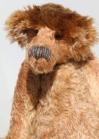 Ludwyn has amber translucent glass eyes (proper teddy bear eyes) and an impressive nose meticulously embroidered from two types of wool