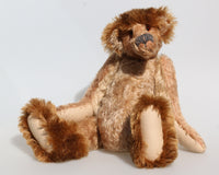 Ludwyn Gumboots is an elderly wanderer, a veteran mohair artist bear from Barbara-Ann Bears, he stands 16.5 inches (42cm) tall and is 11.5 inches (29cm) sitting.  Ludwyn Gumboots is a bear of the 1990s, a bear from our transition from the traditional into the wild and wonderful world of Barbara-Ann Bears